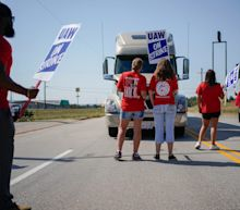 'Truly saved my life': GM workers on strike fight for benefits as automaker's profits soar