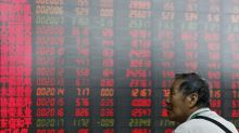 World shares mostly rise after Fed signals US rate cut