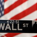 Wall Street ends choppy day higher; tech helps, Brexit weighs