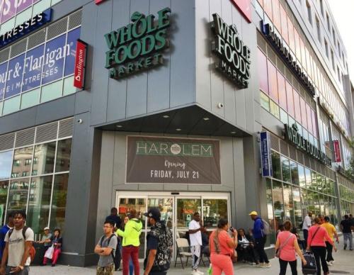 People walk past whole foods