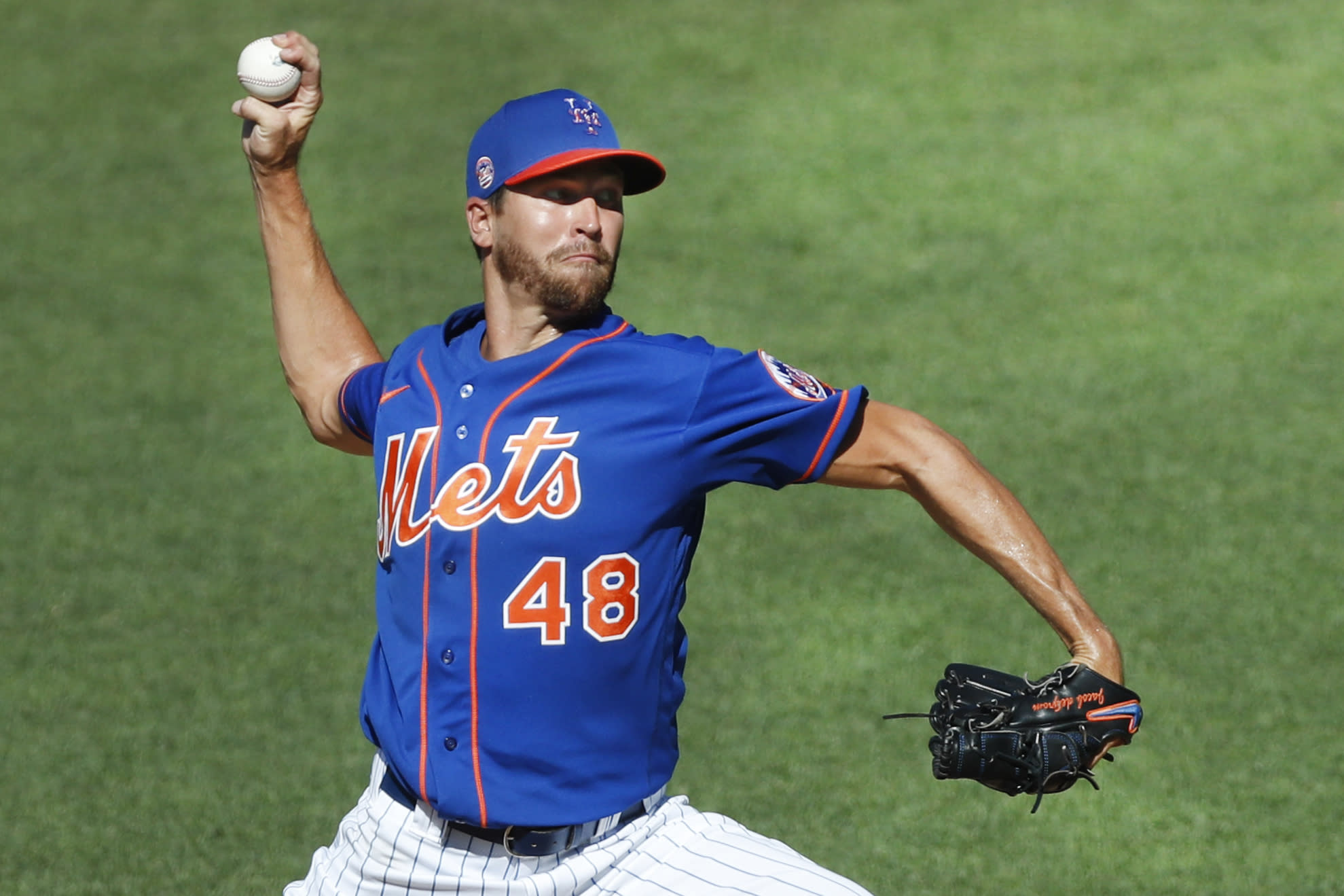 New York Mets starting pitcher Jacob deGrom (48) winds up while delivering a pitch during a simulated game, part of the Mets summer training camp workout at Citi Field, Thursday, July 9, 2020, in New York. (AP Photo/Kathy Willens)