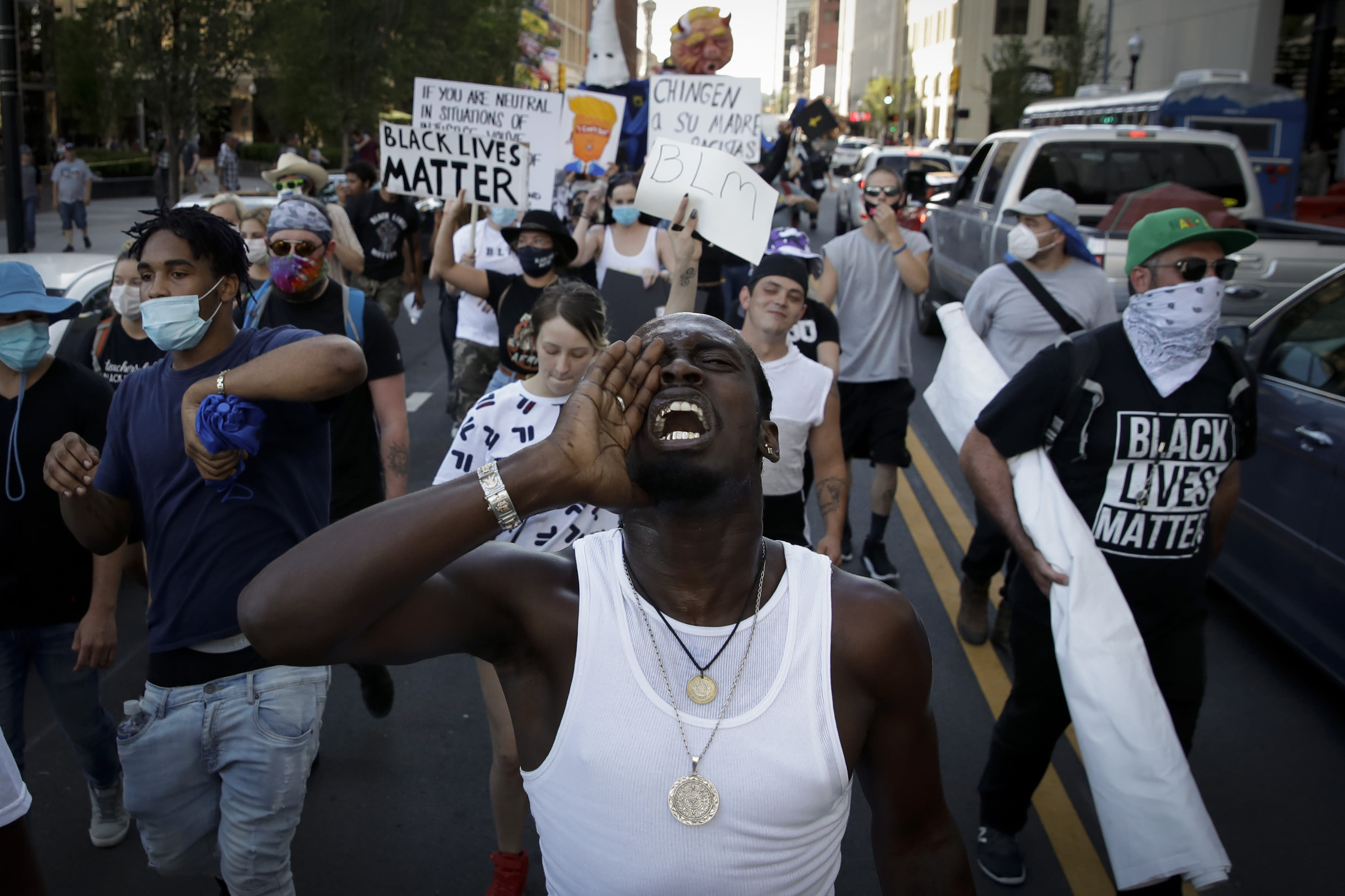 FILE - In this June 20, 2020, file photo, demonstrators march outside the BOK Center where President Trump will hold a campaign rally in Tulsa, Okla. (AP Photo/Charlie Riedel, File)
