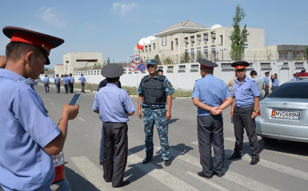Police officers gather outside the Chinese embassy in the Kyrgyz capital Bishkek on August 30, 2016 following a suicide bombing (AFP Photo/Vyacheslav Oseledko)