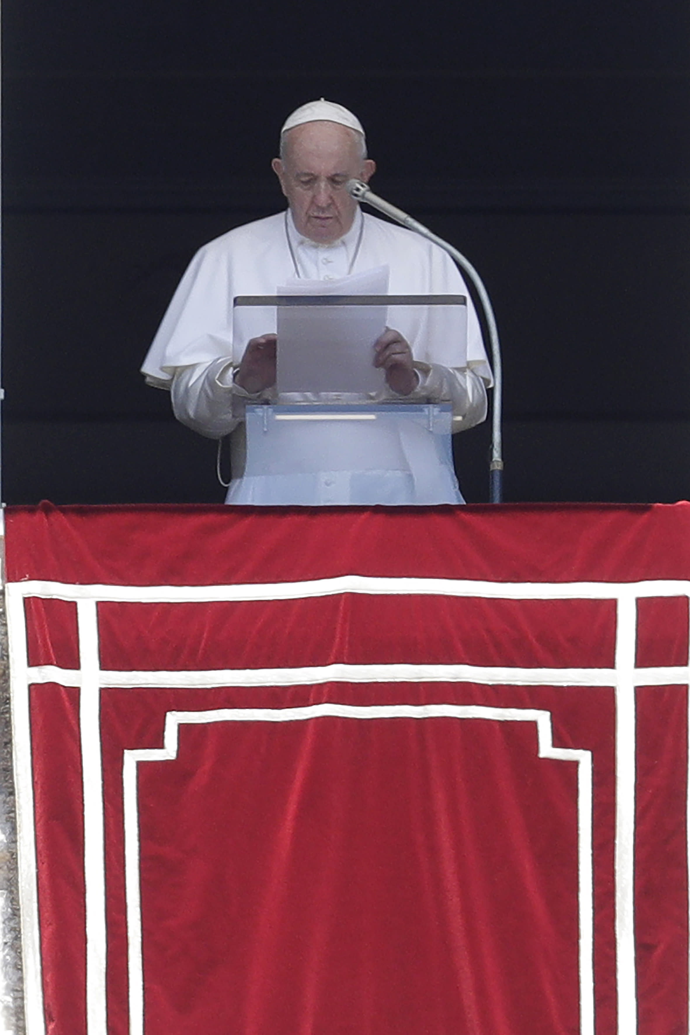 Pope Francis prays for the dead and injured of the three U.S. mass shootings, during the Angelus noon prayer in St. Peter's Square at the Vatican, Sunday, Aug. 4, 2019. Francis told a crowd gathered in St. Peter's Square for the weekly Angelus blessing Sunday that ''I am spiritually close to the victims of the episodes of violence that have bloodied Texas, California and Ohio, in the United States, striking defenseless people.'' (AP Photo/Gregorio Borgia)
