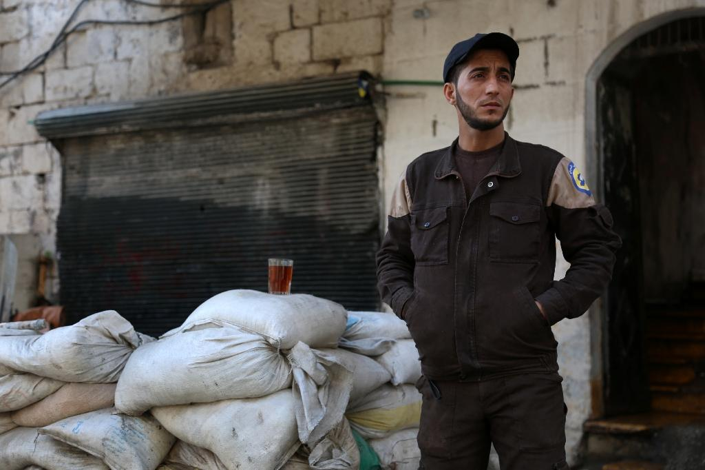 A member of Syrian emergency personnel drinks tea at their centre on February 29, 2016 in the Bab al-Nairab neighborhood of Aleppo (AFP Photo/Karam al-Masri)