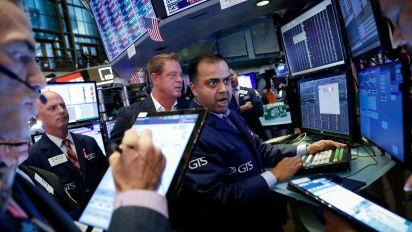 Stocks slip amid earnings, weak China data