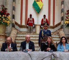Bolivia blames Cubans for stirring unrest, ousts Venezuelan officials