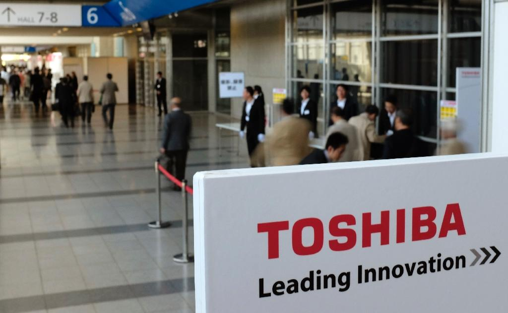 Toshiba said it was now seeking around $27 million from five former top managers, including a trio of presidents, for their role in the fraud (AFP Photo/Kazuhiro Nogi)