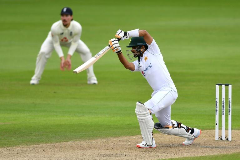 Elegant fifty - Pakistan's Babar Azam drives on the first day of the first Test against England at Old Trafford (AFP Photo/Dan MULLAN)
