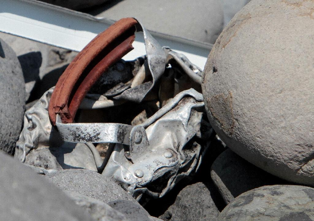 A photo shows metallic debris found on a beach in Saint-Denis on the French Reunion Island in the Indian Ocean, close to where where a Boeing 777 wing part believed to belong to missing flight MH370 washed up last week (AFP Photo/Richard Bouhet)