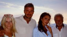 David and Victoria Beckham pose with their parents in Greek holiday snaps