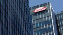 Takeda operating profit halves, looks to asset sales to shore up finances