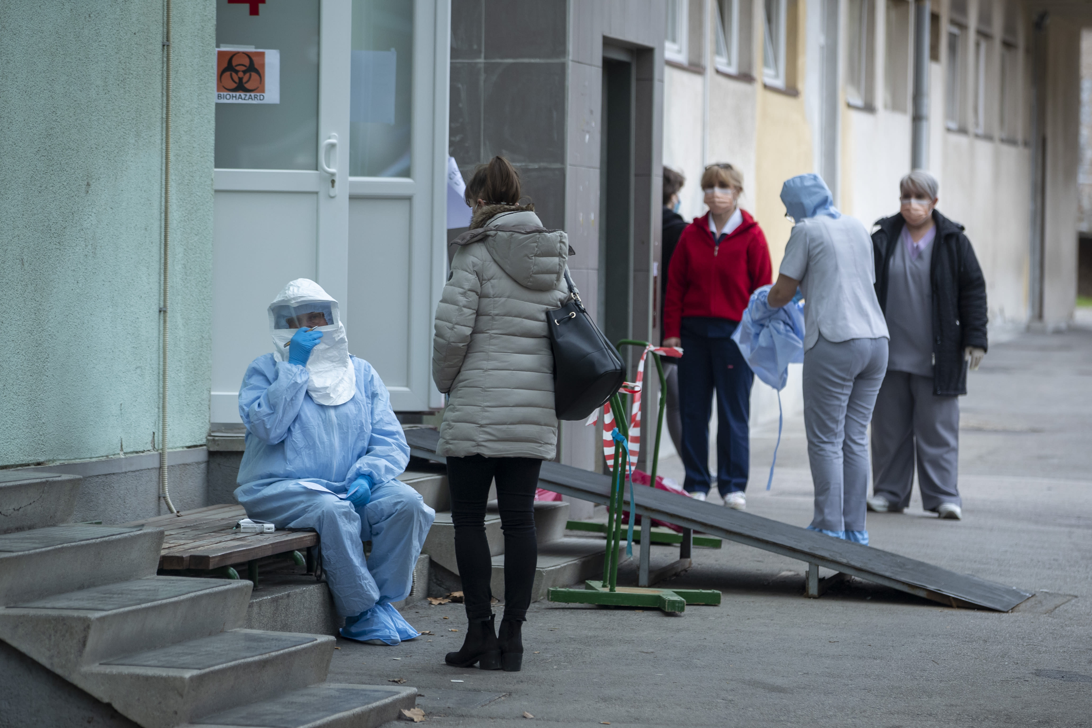A health worker takes notes at the infectious disease clinic in Zagreb Croatia where the first coronavirus case in Croatia is hospitalized Tuesday Feb. 25 2020. Croatia confirmed its first case of coronavirus in a man who had been to Milan the capit
