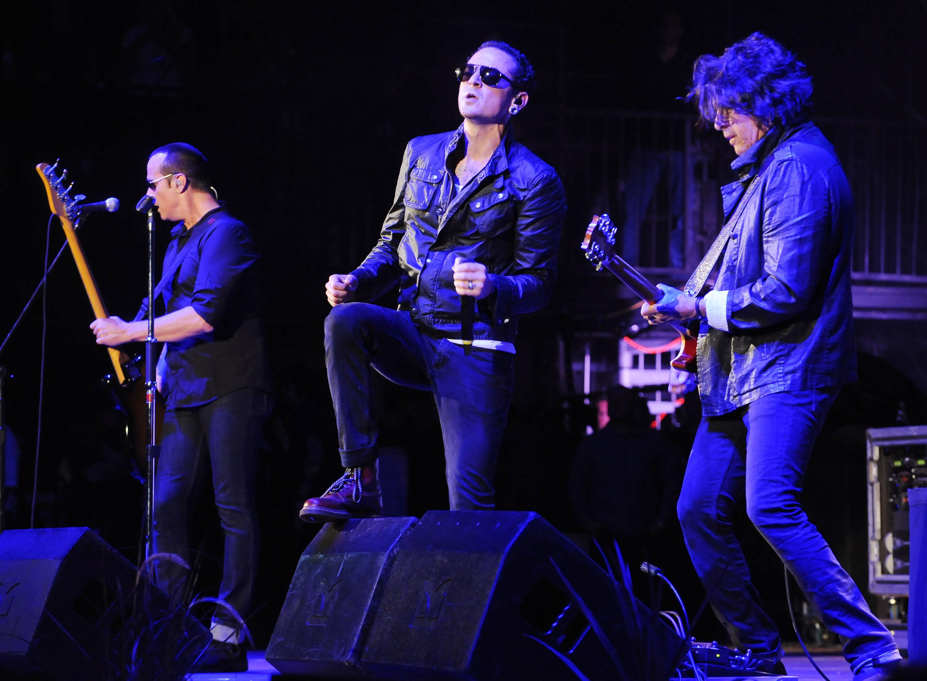 FILE - In this Saturday, May 18, 2013 file photo, Stone Temple Pilots performs at the 2013 KROQ Weenie Roast at the Verizon Wireless Amphitheatre in Los Angeles. Stone Temple Pilots have accused the band's former frontman Scott Weiland of hijacking its name and songs to promote his solo career. The lawsuit filed Friday, May 24, 2013, in Los Angeles accuses Weiland of being chronically late to concerts and interfering with the release of a new single by the group. (Photo by Katy Winn/Invision/AP, file)