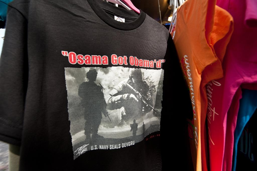 "A T-shirt reading ""Osama Got Obama'd"" is displayed at a souvenir stand near the White House in Washington in May 2011 (AFP Photo/Nicholas Kamm)"