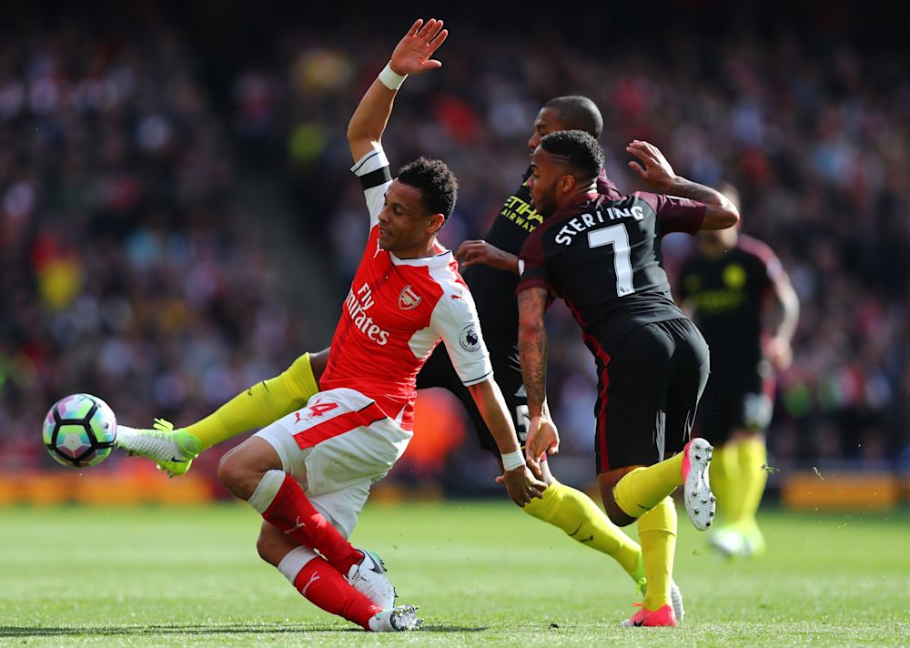 Francis Coquelin of Arsenal is challenged by City players