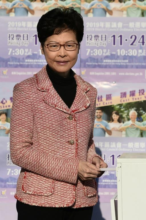 Hong Kong Chief Executive Carrie Lam casts her vote during district council elections (AFP Photo/YE AUNG THU)