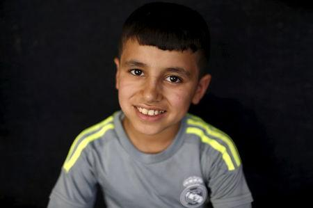 Freed Yazidi boy Murad, 9, who was trained by Islamic State, smiles at a refugee camp near the northern Iraqi city of Duhok April 19, 2016. REUTERS/Ahmed Jadallah