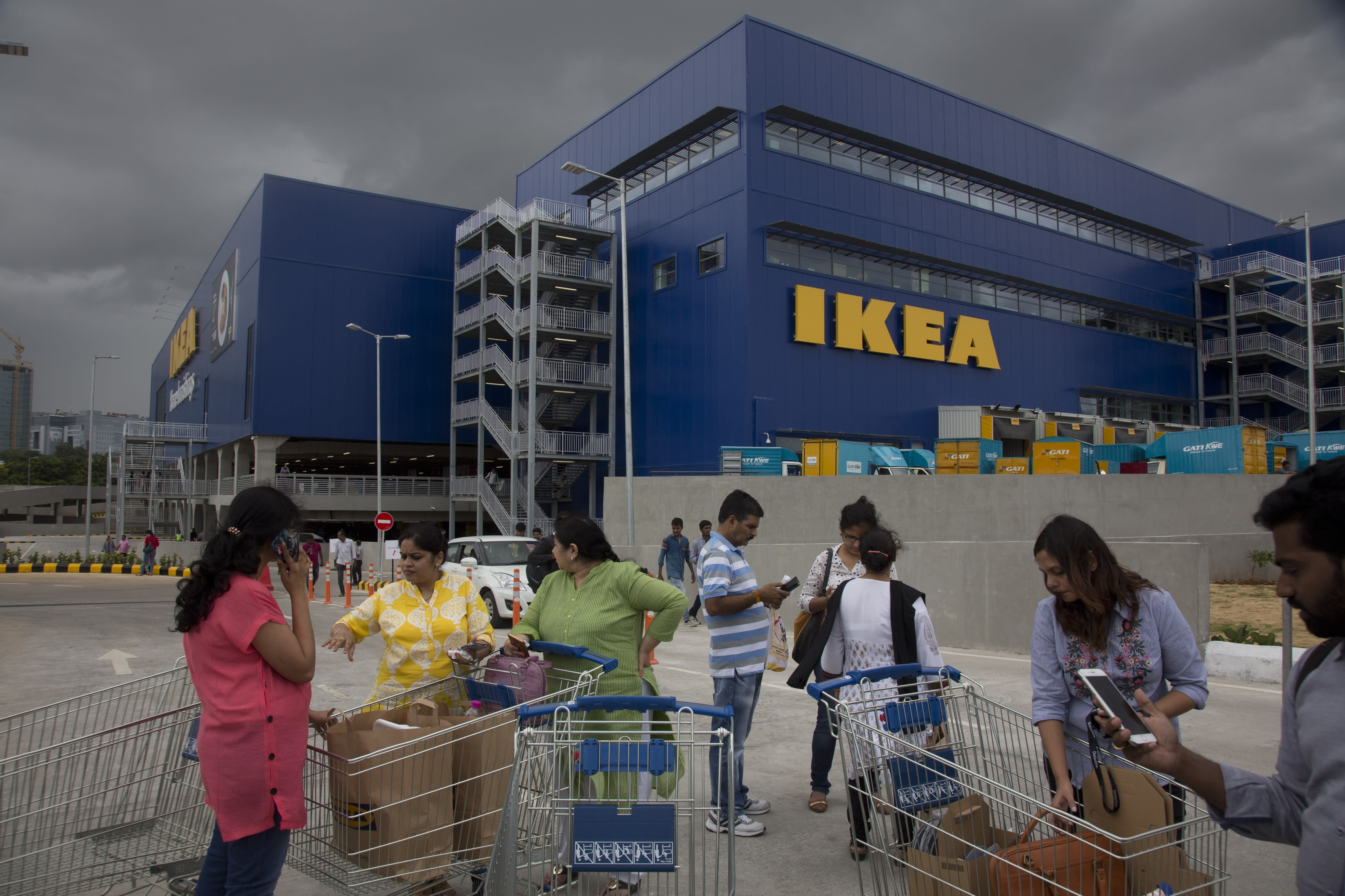 Indian customers stand outside IKEA's first store in India as it opened in Hyderabad, India, Thursday, Aug.9, 2018. Swedish home furnishings giant IKEA opened its first store in India on Thursday, five years after it received approval to invest in the country's single-brand retail sector. (AP Photo/Mahesh Kumar A.)