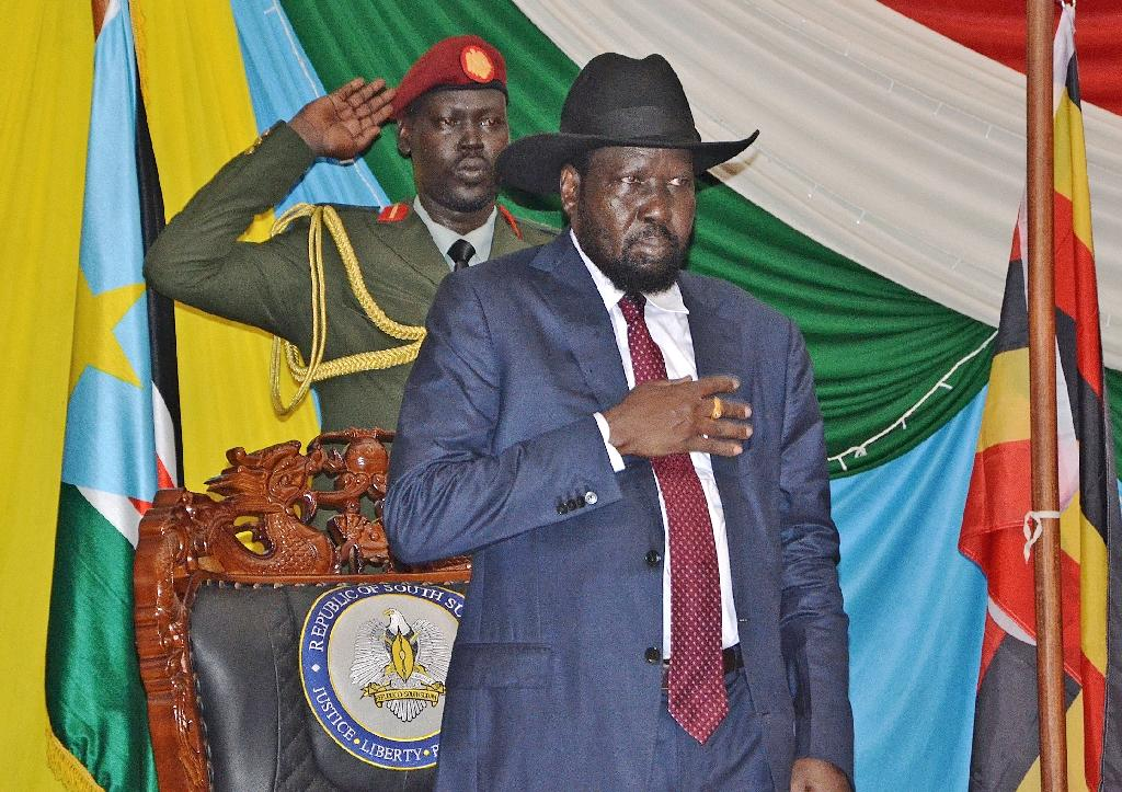 South Sudan's President Salva Kiir (C) before signing peace agreement in Juba on August 26, 2015