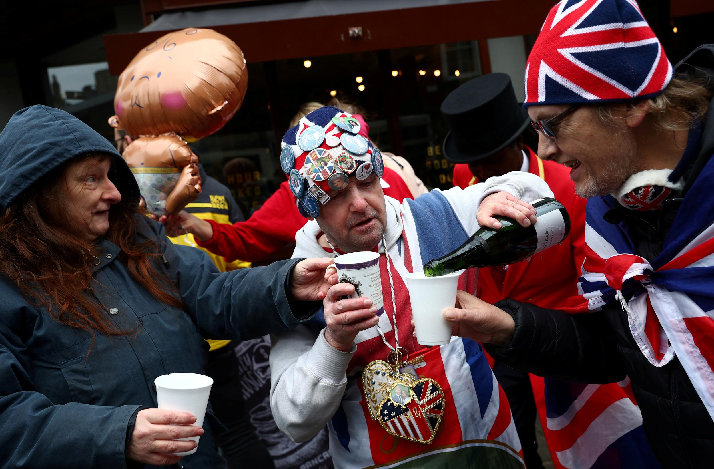 People celebrate the birth of the baby of Britain's Meghan, the Duchess of Sussex at Windsor Castle in Windsor, Britain May 6, 2019. REUTERS/Hannah McKay