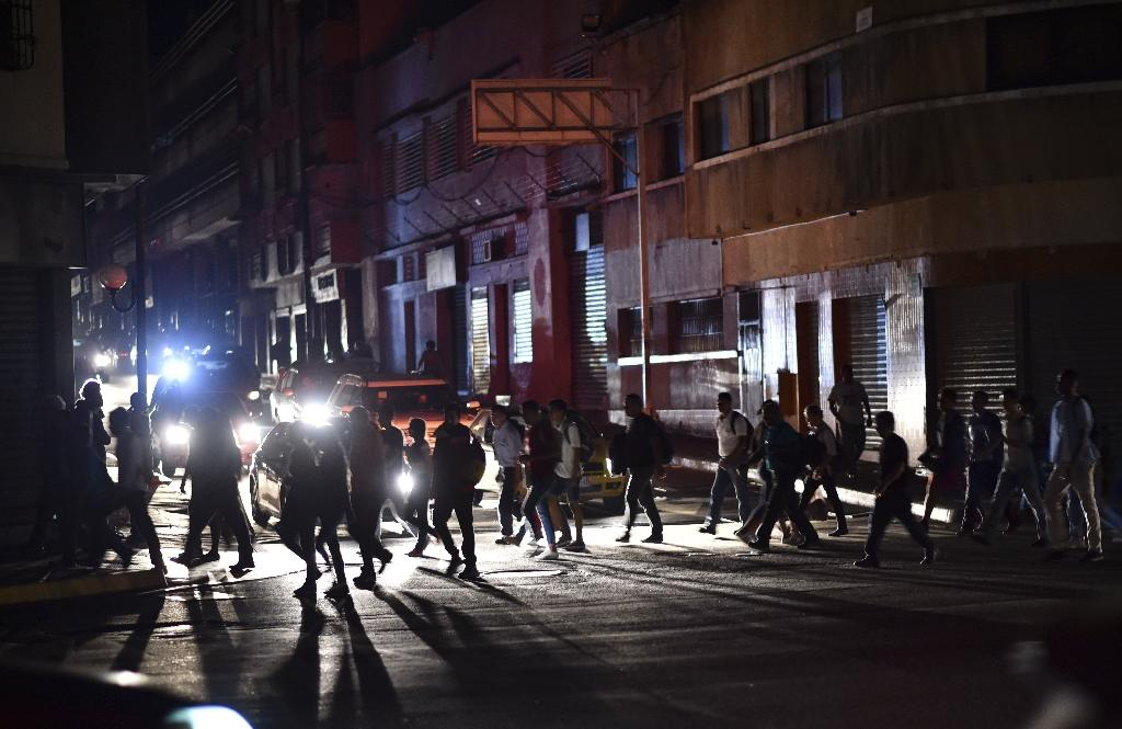 Caracas is one of the world's most crime-ridden cities, so people set out for home early during the blackout (AFP Photo/YURI CORTEZ)