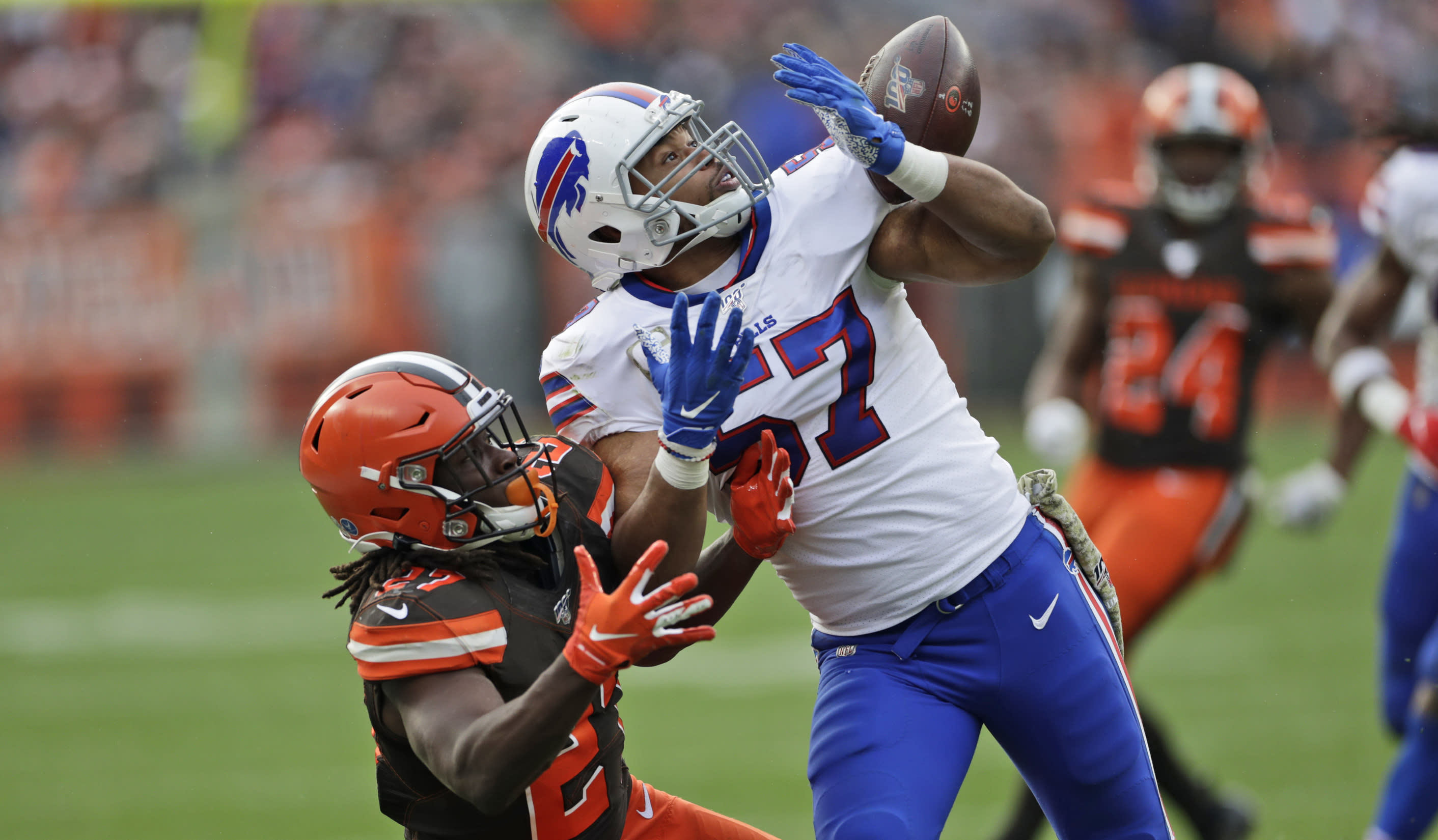 Buffalo Bills outside linebacker Lorenzo Alexander (57) breaks up a pass intended for Cleveland Browns running back Kareem Hunt (27) during the second half of an NFL football game, Sunday, Nov. 10, 2019, in Cleveland. (AP Photo/Ron Schwane)
