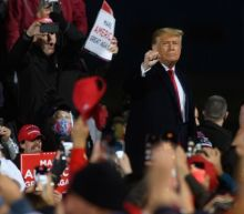 Trump tells Pennsylvania rally 'nobody wants me' before cutting event short and dancing off stage to YMCA