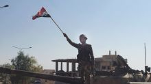 Syrian troops surround Turkish post in country's northwest