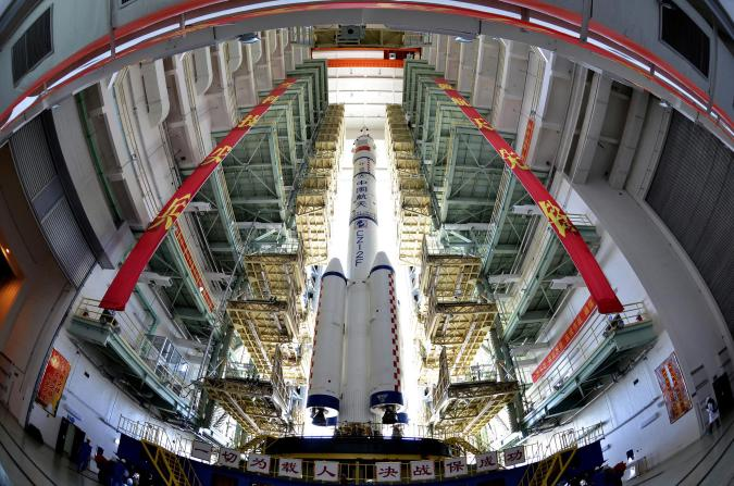 The Shenzhou-9 manned spacecraft, Long March-2F rocket, and escape tower wait to be transferred to the launch pad at the Jiuquan Satellite Launch Center, Gansu province June 9, 2012. China will launch its Shenzhou-9 manned spacecraft sometime in mid-June to perform the country's first manned space docking mission with the orbiting Tiangong-1 space lab module, a spokesperson with the country's manned space program said here Saturday, Xinhua News Agency reported. REUTERS/China Daily  (CHINA - Tags: SCIENCE TECHNOLOGY TPX IMAGES OF THE DAY) CHINA OUT. NO COMMERCIAL OR EDITORIAL SALES IN CHINA