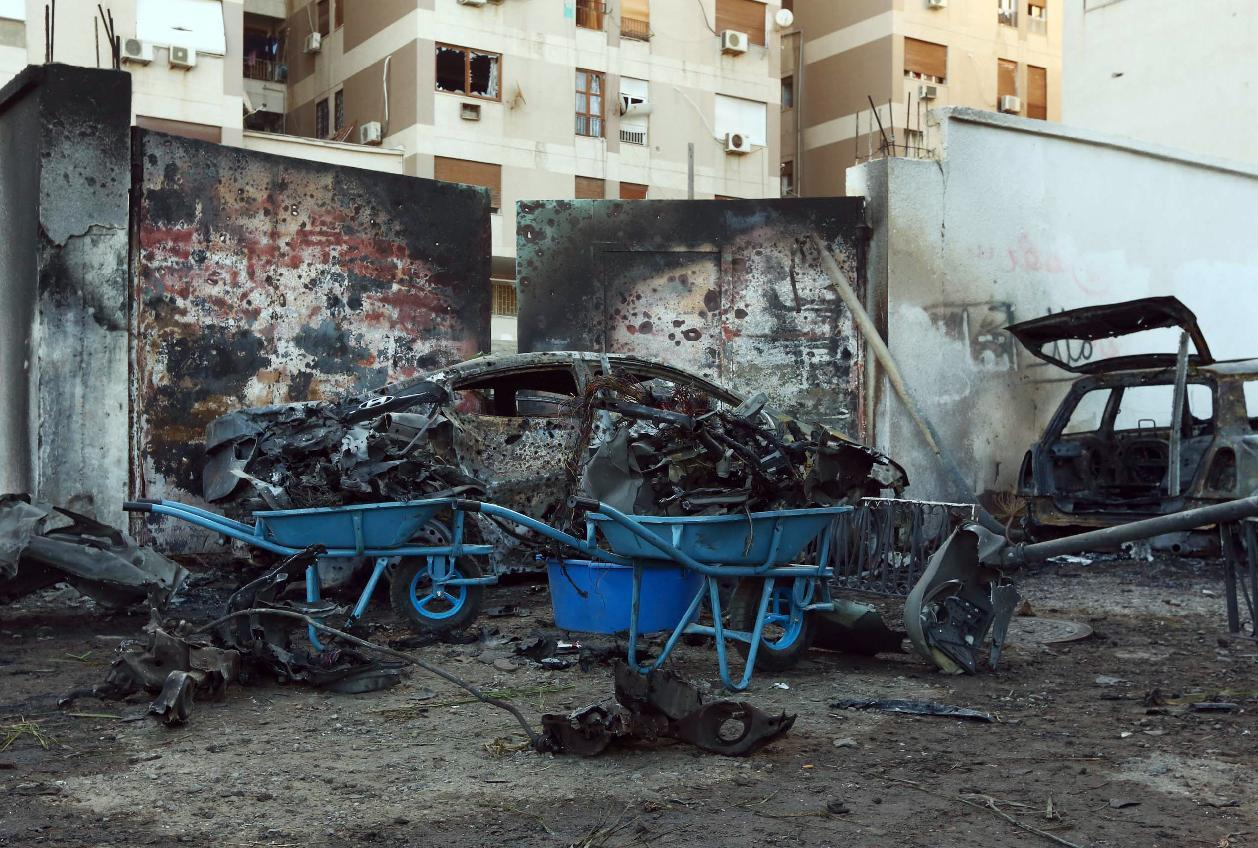 A destroyed vehicle is seen near the compound of the Egyptian embassy in the Libyan capital Tripoli on November 13, 2014 after it was targeted by a car bomb explosion (AFP Photo/Mahmud Turkia)