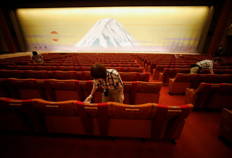 Workers disinfect seats at the Kabukiza Theatre amid the coronavirus disease (COVID-19) outbreak in Tokyo