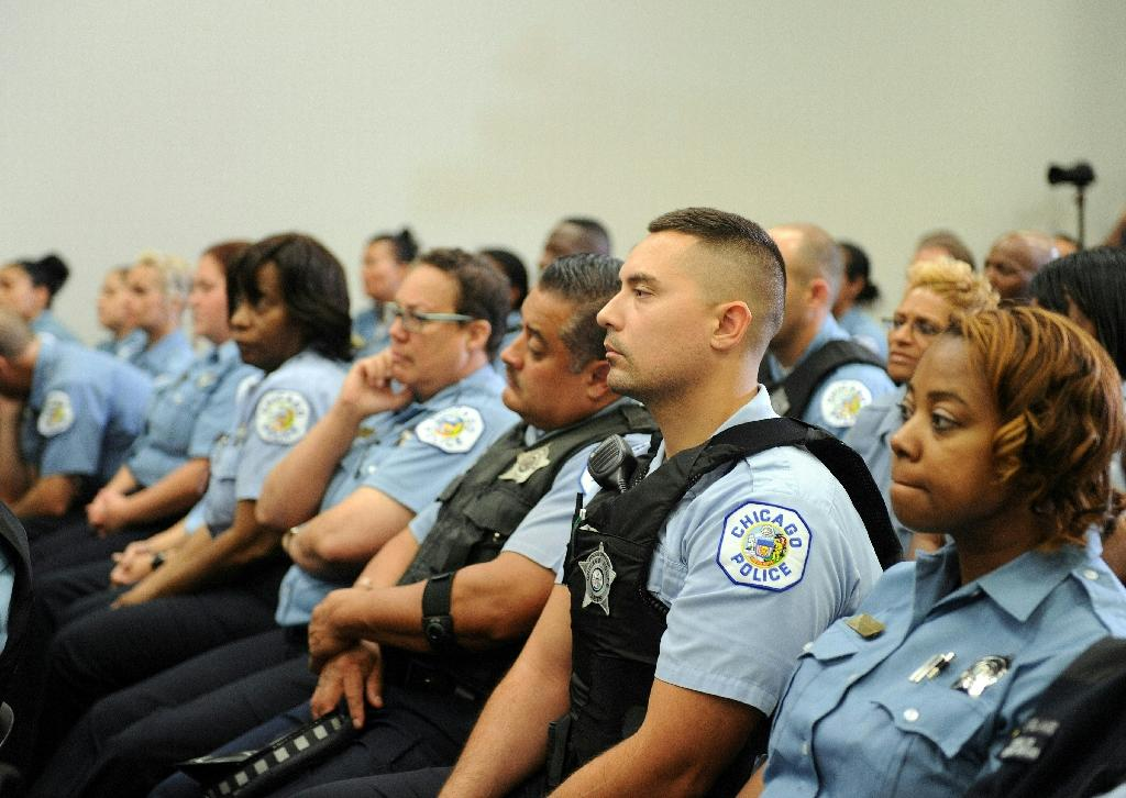 Chicago police officers listen as the police department speaks during a conference in Chicago on September 21, 2016 (AFP Photo/Nova Safo)