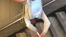 Man Hangs Upside Down While Playing Flute in NYC Subway Station
