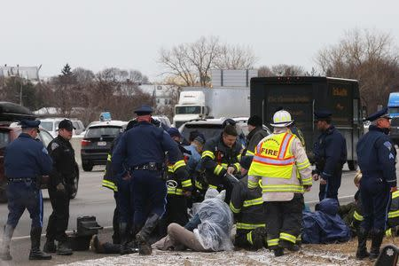 Police detain a group of protesters who blocked Interstate 93 southbound during the morning rush hour in Somerville, Massachusetts January 15, 2015. REUTERS/Brian Snyder