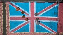Pound slides as UK rate hike prospect dims