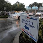 Florida residents line up in the rain to early vote