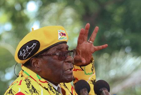 President Robert Mugabe gestures as he addresses a rally in Harare