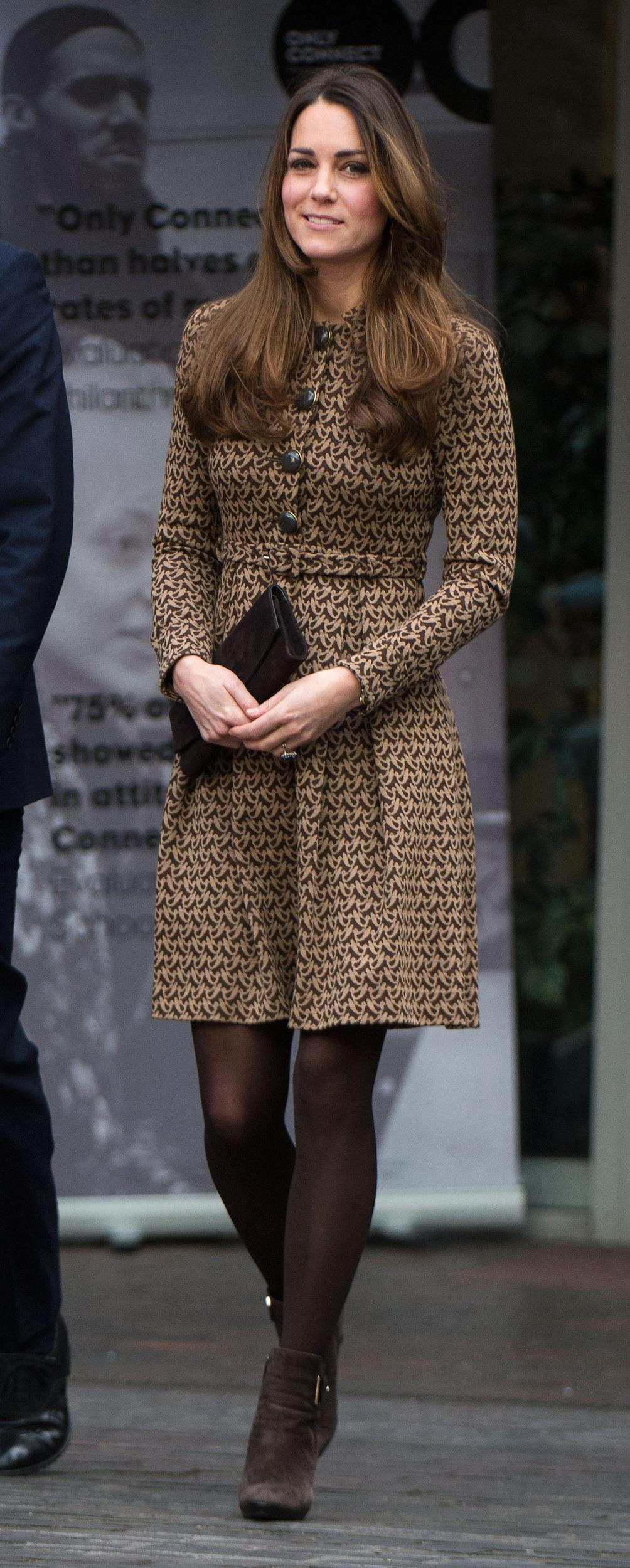 Kate recycled an Orla Kiely dress and her Aquatalia boots for a charity visit with William.