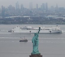 Photos show the 1,000-bed Navy hospital ship USNS Comfort arriving in New York to support the city in its fight against the coronavirus