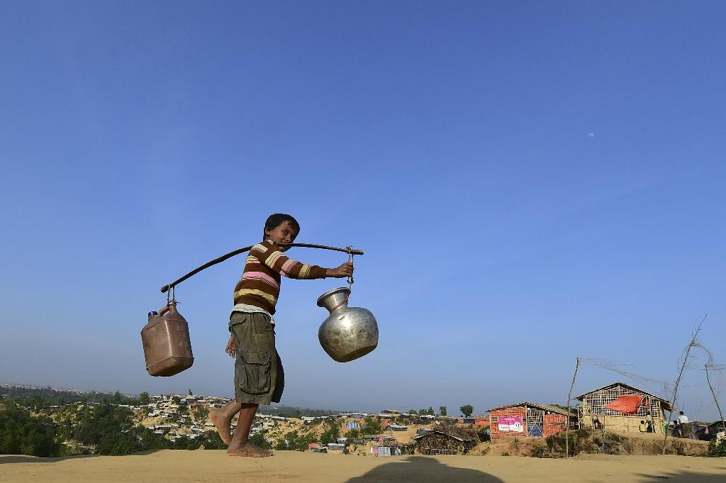 Some 700,000 Rohingya have fled an army crackdown in Rakhine, mostly across the border to Bangladesh where they live in refugee camps (AFP Photo/Munir UZ ZAMAN)