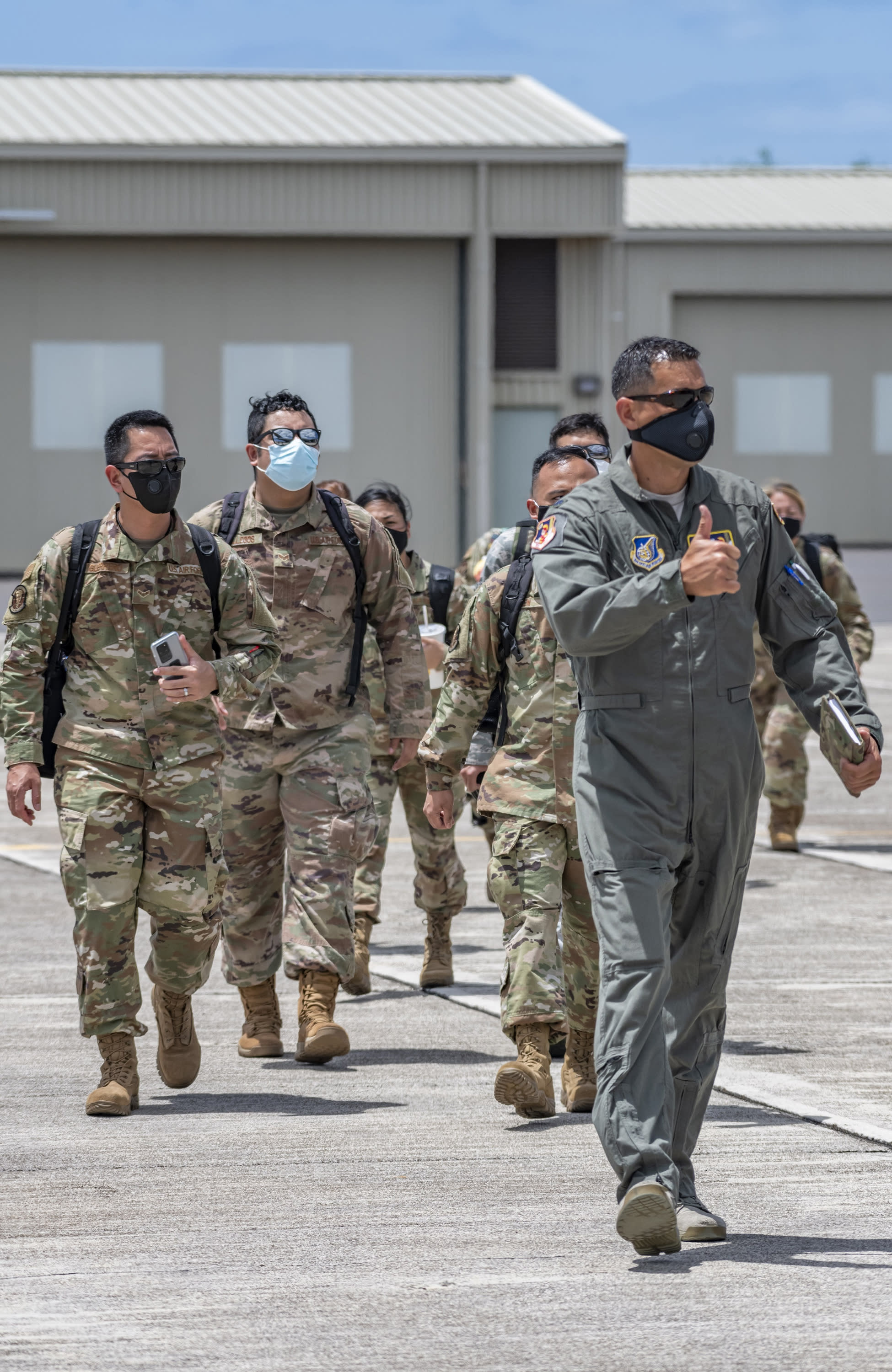 In this April 17, 2020, photo provided by the Hawaii National Guard, is Lt. Col. Kai Kahele, right, leading a group of soldiers and airmen at Kalaeloa Airfield in Kapolei, Hawaii. Kahele is the only major candidate in the race to succeed U.S. Rep. Tulsi Gabbard, virtually guaranteeing he will be sworn in as Hawaii's newest congressman in January. (Sgt. John Schoebel/Hawaii National Guard via AP)