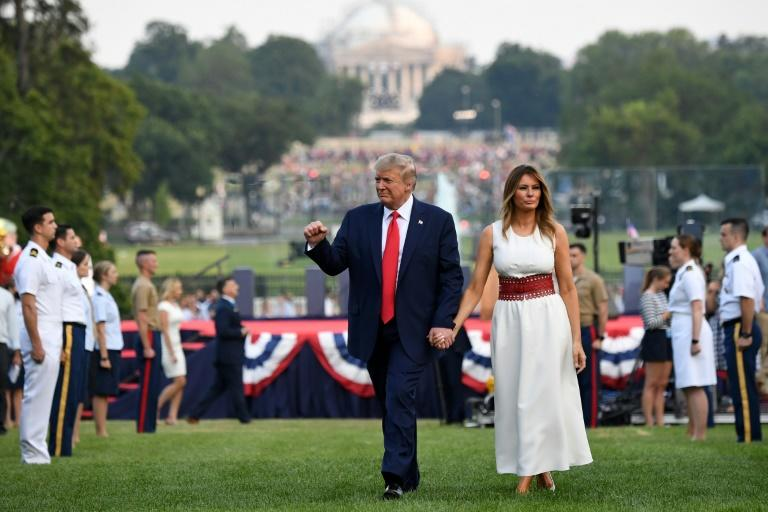 """US President Donald Trump and first lady Melania Trump host the 2020 """"Salute to America"""" on the South Lawn of the White House on July 4, 2020 (AFP Photo/SAUL LOEB)"""