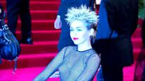 Miley Cyrus Looks All White as She Rocks Pig Tails in the Rain