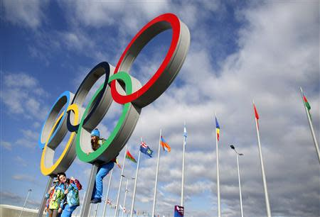 Volunteers pose for a photograph in the Olympic Rings ahead of the 2014 Sochi Winter Olympics