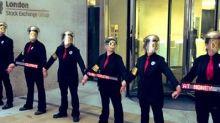 Extinction Rebellion members glue themselves to London Stock Exchange