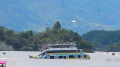 Rescue operation under way as boat in Colombia carrying 150 tourists sinks in reservoir