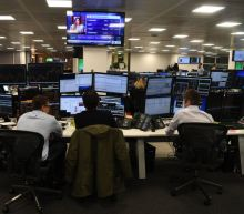 FTSE 100 closes above 7,000 with positive data from US, Sensex slips after opening