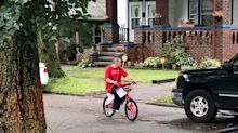 Cops surprise teenager bullied for riding his sister's pink bike with new ride