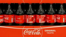 Coke warns of pain from UK sugar tax, U.S. freight costs